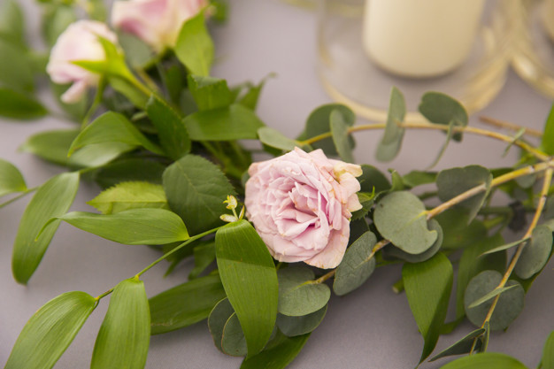 beautiful-branch-with-pink-rose-table-decorations-wedding_73107-1153.jpg
