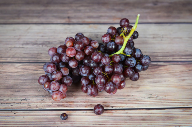 red-grape-wooden-table-bunch-grapes-juicy-fruit_73523-2287.jpg